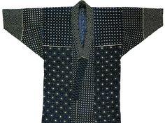 Awaji island fishermens coat made of indigo-dyed cotton covered with white sashiko quilting stitches.