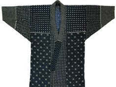 Awaji island fishermens coat made of indigo-dyed cotton covered with white sashiko quilting stitches.