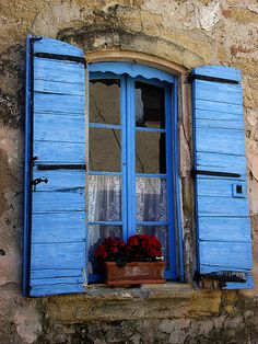 Blue window and window flower box!! Must be in France, there's lace at the window!!! Also love the blue painted window and the sweet little arch across the top to match the beautiful blue wood shutters!!! Fab Fab