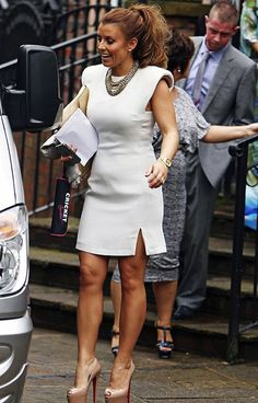 Coleen Rooney got ready for the races last week in a fabulous all-white Lanvin dress from CRICKET, which features on-trend padded shoulder pads.