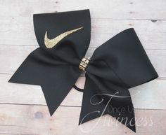 "This cheer bow is made with high quality US made 3"" grosgrain ribbon. Theswoosh is made with sparkly gold glitter vinyl. The center is made with gold rhinestone mesh. This has 1 layer of ribbon and is"