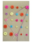 Want to add a little craftiness to preschool math? Break out the glue gun and create this button board!