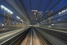 Slow shutter train photos. Amazing. Yurikamome tracks, Tokyo Japan by Appuru Pai.