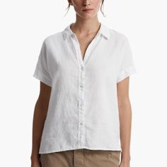 Canvas Linen shirt. Clean finished shirt collar. Front placket with button closures. Short sleeves with cuff detail. Step bottom hem with side vent details. Canvas Linen (KO) is soft, breathable and cool to the touch, making this an excellent lightweight shirt option for the Summer. Additional Information:• 100% Linen • Fabric: KO• Imported• Garment dyed with extra softeners for a soft, lived in feel• Front Length: 25 1/2 in.• Back Length: 26 1/2 in.