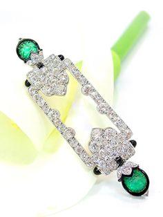 "An exclusive Art Déco diamond and emerald brooch circa 1920, signed ""Cartier Paris"", platinum"