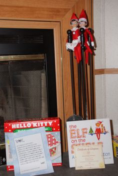 The Elf on the Shelf : Doe brought Hello Kitty house and Rase brought his adoption cert.