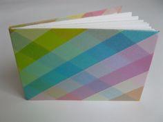 http://carlajimison.typepad.com/carla_jimison/2011/01/small-books-with-japanese-washi-tape.html    visit my blog: colourfulway.blogspot.com