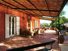 The beautifully furnished covered terrace of Villa Maria, an elegant and luxurious villa with stunning views on the Egade islands, close to Marsala.