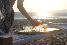 Sunset pour on the beach at a St. Barth beach barbecue   Gather