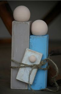 simple wooden blocks with wooden heads glued on and tied with twine.