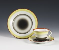 Plate and coffee cup by Nora Gulbrandsen for Porsgrund Porselen. Model 1877 designed in 1930.