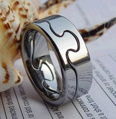 COI Tungsten Carbide Puzzle Ring - TG1378. Half to Chris, half to me. Love this idea <3