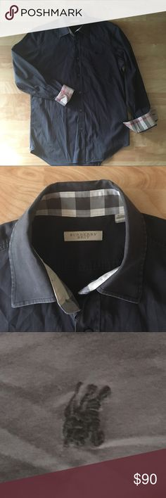 BURBERRY BRIT men's black button down shirt Nice black long sleeve button down genuine Burberry shirt with that Burberry classic plaid on its fold up cuffs. Classic fit. Good pre-owned condition, slight color fade on edges of collar. 97% cotton, 3% elastolefin. Burberry Shirts