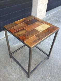 This charming end table is the perfect combination of rustic and contemporary style. Elegance with warmth, it is a mixture of hardwood species Barnwood Bricks® on a metal base.