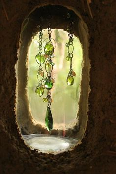 a crystal necklace, within a bottle, built into the cob wall. While I like this, what would drive me crazy is if the thing broke or fell apart or something: how would you fix it?