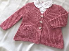 Ravelry: Baby - Girls textured V neck cardigan with detailed pocket P050 pattern by OGE Knitwear Designs