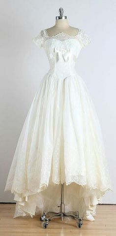 The most gorgeous wedding dress in existence. Short, white, and stunningly detailed.
