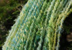 Green kid mohair corespun yarn by Judy_Kavanagh, via Flickr