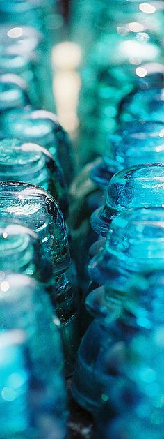 bought a whole box of teal glass insulators at the Antique FleaMarket.  | Flickr - Photo Sharing!