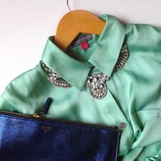 Vince Camuto mint blouse Silky feel! I love this shirt but it's too big for me. No flaws. Tie-front style with subtle elastic back. Two front pockets. Vince Camuto Tops Button Down Shirts