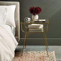 Curved Terrace Nightstand | Sleek and streamlined in glass and antique brass-finished metal, our Curved Terrace Nightstand brings mid-century style to the bedroom with its retro silhouette.
