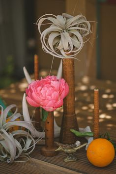 Old wooden spools centerpieces styled by AandBStyle.com photo by DelbarrMoradi.com