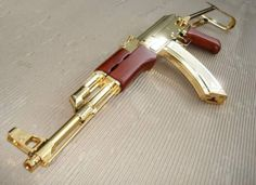 Golden AK-47 with red grips. Interesting!