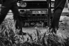 Gianfranco Tripodo, Italia, Contrasto Melilla, Spagna, 24 aprile 2014 Un immigrato sub-sahariano si nasconde sotto un'auto; alla fine è riuscito a scappare ed entrare nell'enclave spagnola di Melilla. World Press Photo, General News