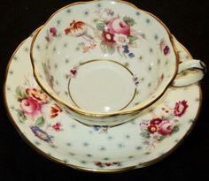 GEORGE JONES ENGLAND PINK ROSE BOUQUET WHITE TEA CUP AND SAUCER ANTIQUE