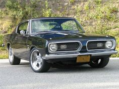 My dad had this same car when I was a kid...till my brother wrapped it around a tree:(  Google Image Result for http://static.cargurus.com/images/site/2010/03/11/16/34/1972_plymouth_barracuda-pic-6485054177969963302.jpeg