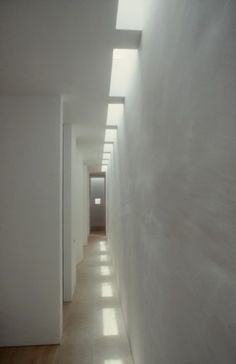 minimalist interior by JOHN PAWSON & CLAUDIO SILVESTRIN, Neuendorf villa, Majorca, spain. recessed ceiling lights/windows