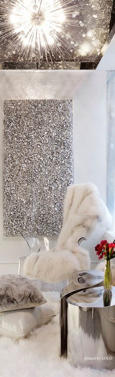 A faux fur throw and glitter wall art! How much more glam could you get? Snow queen spa spot here!