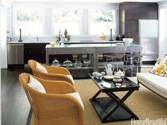 "The kitchen in this Bridgehampton, New York, home blends seamlessly with the family room. ""I wanted an all-purpose room rather than a traditional kitchen,"" designer Eldon Wong says. ""I wanted it to look more like a family room. The idea was, let's make this a multifunctional space that we can use 24/7. It's all about being with friends, cooking, gabbing, watching TV."