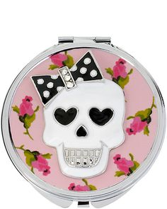 SKULL WITH BOW COMPACT: An alluringly spooky addition to any purse.