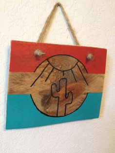 This sign is made from a recycled pallet, and hangs by jute twine. It is hand-painted with turquoise and red paint, and depicts a saguaro cactus and sun. The sign has been sealed with protective wax. Pallets were cared for and given new purpose. In order to help people find purpose and hope 10% of our sales will be donated to To Write Love on Her Arms. This organization helps those with mental illness find support and ways to recover.