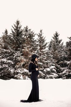 This long-sleeve scoop-neck fitted maternity gown with a mini train is simple elegance. The dress is premium stretch material that provides equal parts comfort and style. Pictured in Black Winter Maternity Photos, Pregnancy Photos, Burgundy Gown, Long Sleeve Gown, Maternity Gowns, Photo Black, Simple Elegance, Maternity Photography, Elegant Dresses