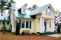 yellow house with green roof - Bing images