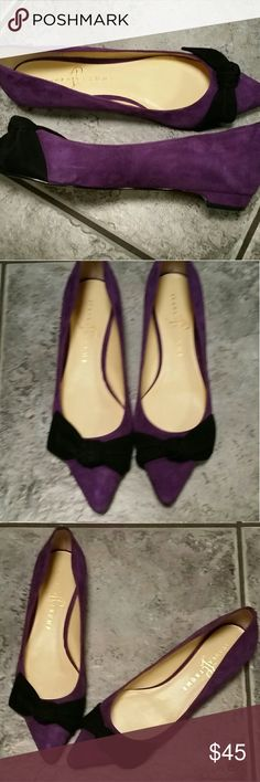 Purple and black suede shoes This is a pair of purple and black suede flats. They are purple with a black bow across the front.  They are a size 8 Medium.  They are Ivanka Trump.  They are new with a tag from Nordstrom Rack still on the bottom. Ivanka Trump Shoes Flats & Loafers