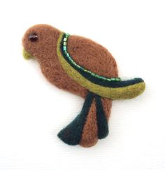 Felt bird brooch, yellow, green and brown needle felted wool badge. $15.00, via Etsy.