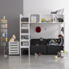 modern bunk design with storage and shelving; nice for preteens and teens. like the shelving/storage in the bed rail