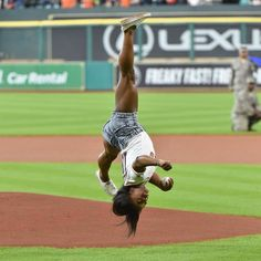 Simone Biles throwing a trick before throwing first pitch out at a Houston Astros game