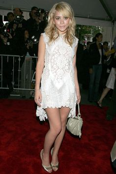 Ashley in a white lace dress at the premiere of Troy in New York.