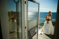 Grand Hotel Wedding Photography with Mackinac Bridge view from deck by Paul Retherford Wedding Photography