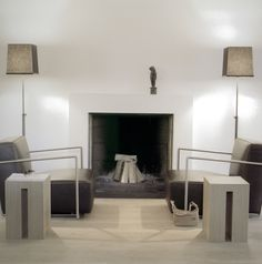 Turn the fire place into a feature area. Add surround to fire place. Arrangement furniture around the fire place.