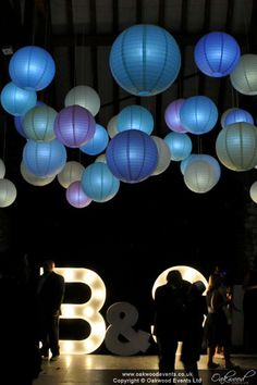 Lit paper lanterns at a barn #wedding #lanternlove