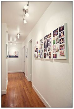 "hallway with ""art gallery"" of family photos"