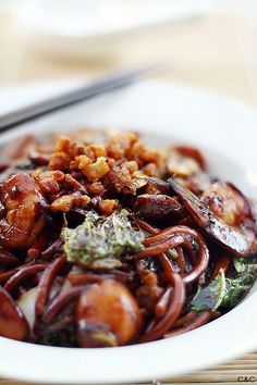 KL Hokkien Mee recipe - This dish is famous for the dark, fragrant sauce that the noodles are braised in. The secret to an authentic KL Hokkien Mee is the pork fat!