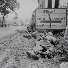 U.S Infantry laying in cover at a crossroad in Belgium, 1944 #ww2 #wwii #us #usa #infantry #soldier #cover #belgium #crossroad