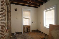 The house has never had a kitchen. this was where we would fit it once walls and the original back door had been repositioned but retained.  #charleston #historic #renovation #redesign #exposedbrick #eastbay #home