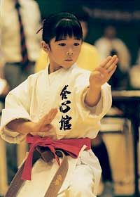 Japan: A girl practicing karate-do, a martial art that hones both physical and spiritual strength (JKF)